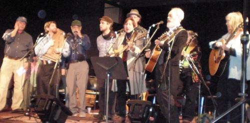 "George Stephens, Lisa Null, Saul Brody, Brendan Phillips, Terry Leonino, Duncan Phillips, Greg Artzner, Cathy Fink and Marcy Marxer ""Singing Through the Hard Times"""